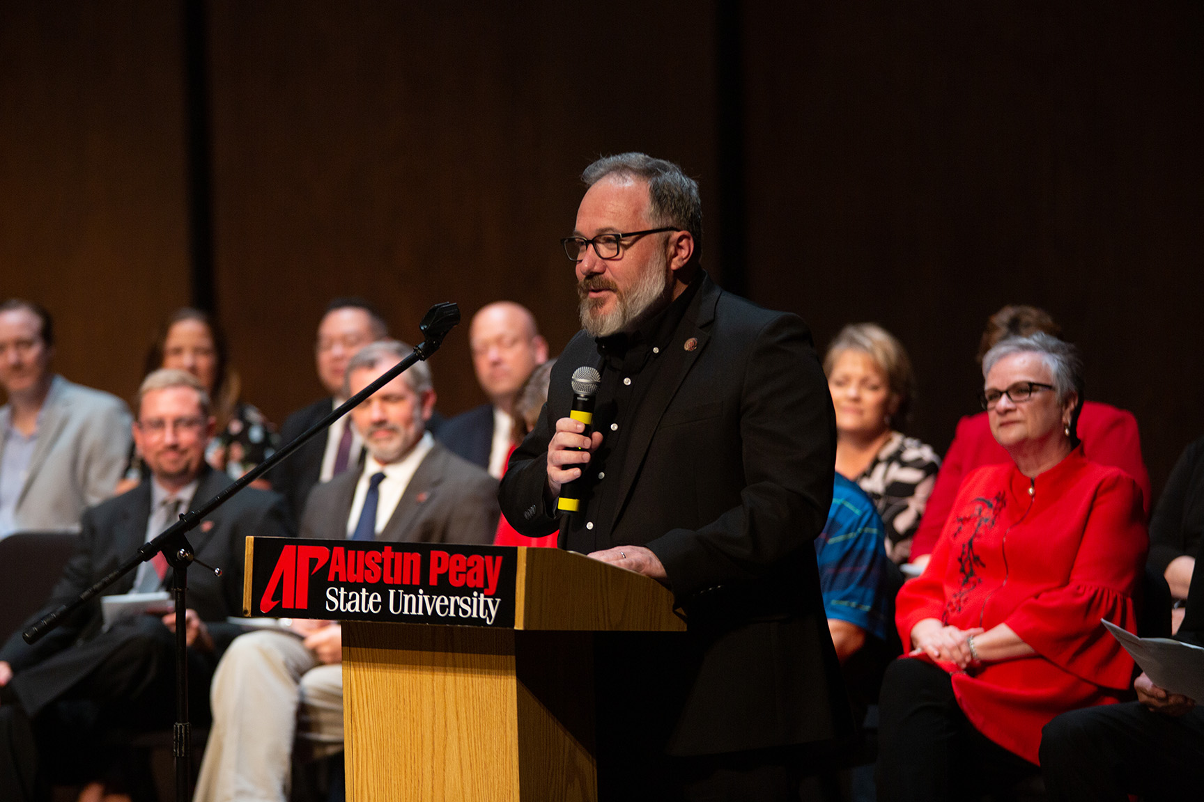 Barry Jones addresses faculty members at awards ceremony