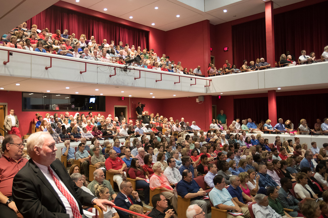 Faculty and staff members sit in Mabry auditorium