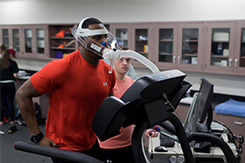 Student runs on treadmill