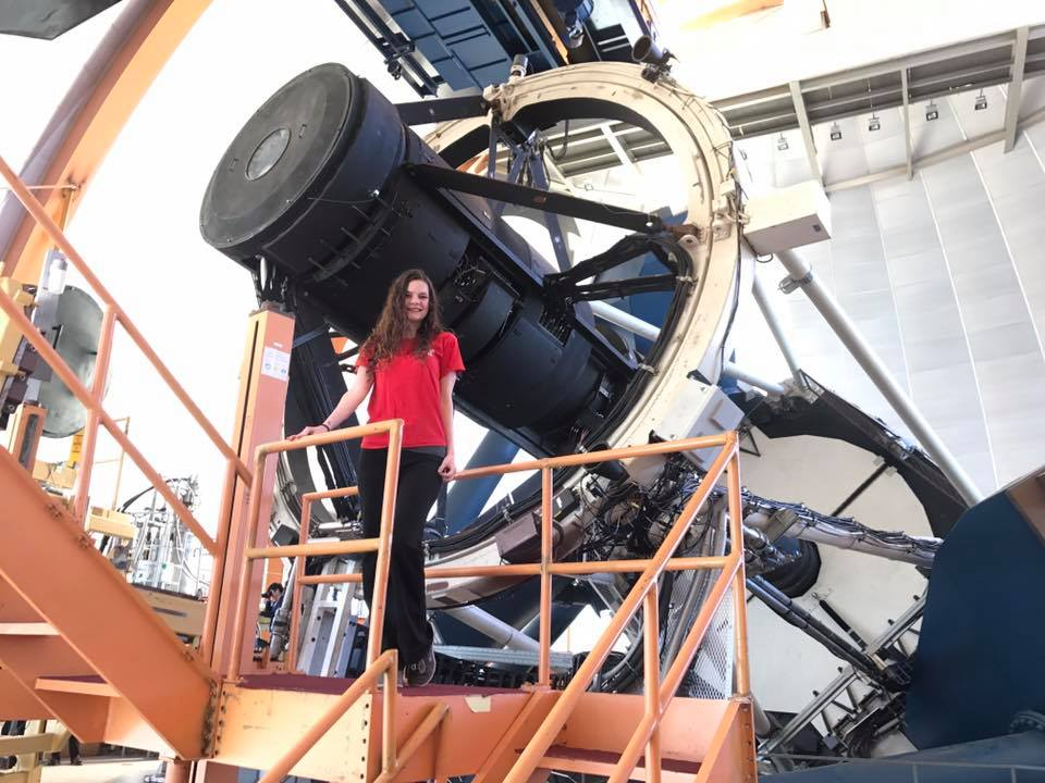 Deborah poses with telescope in Chile
