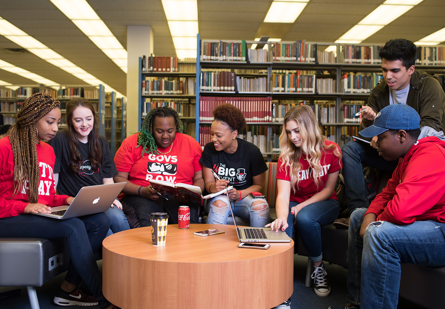 Group of students sits in library