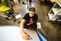 Student works on canvas in Art and Design building lab