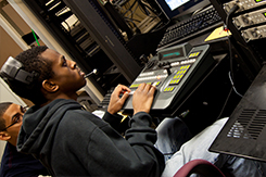 Student operates switchboard