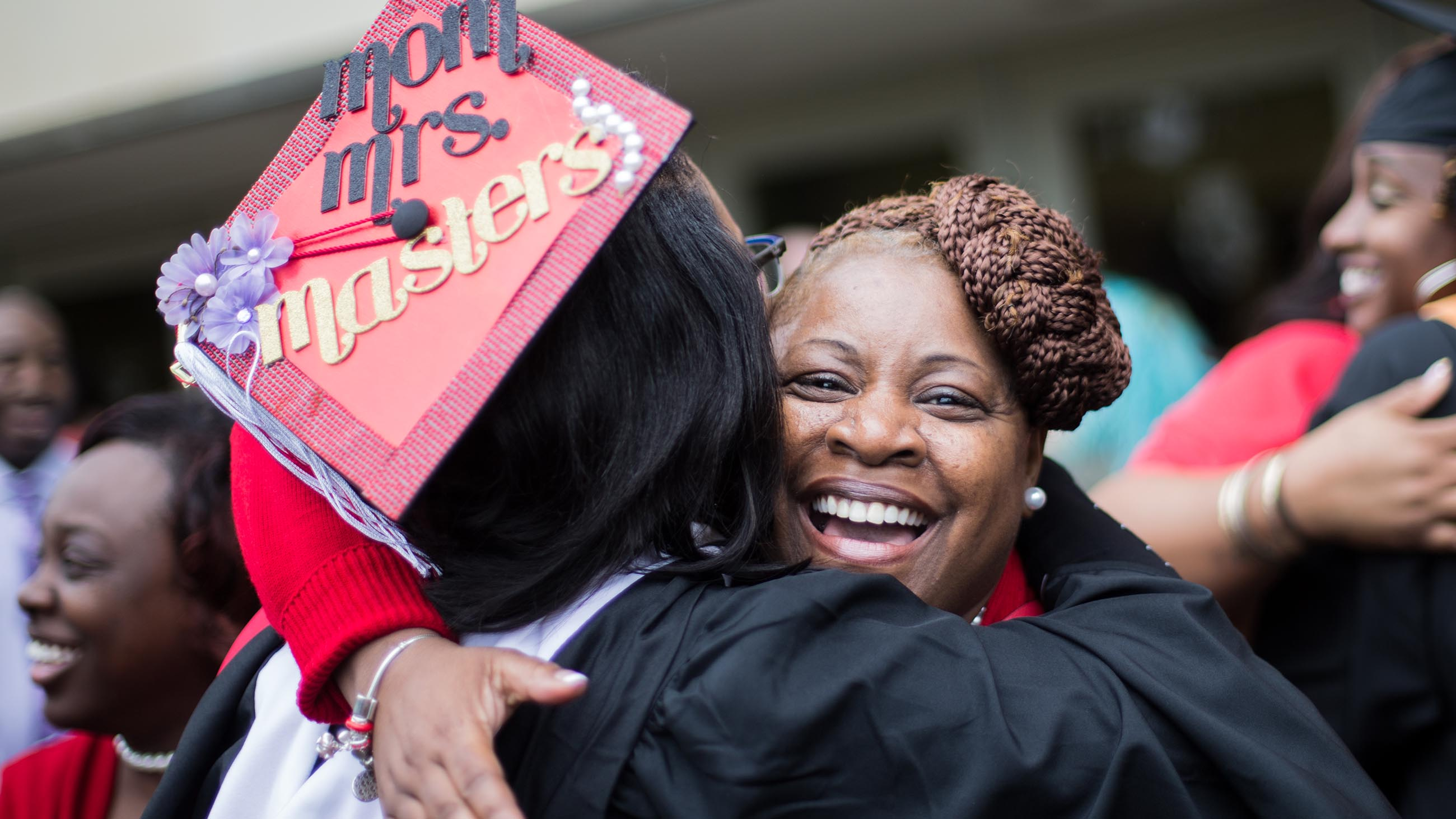 Family members hugging at commencement