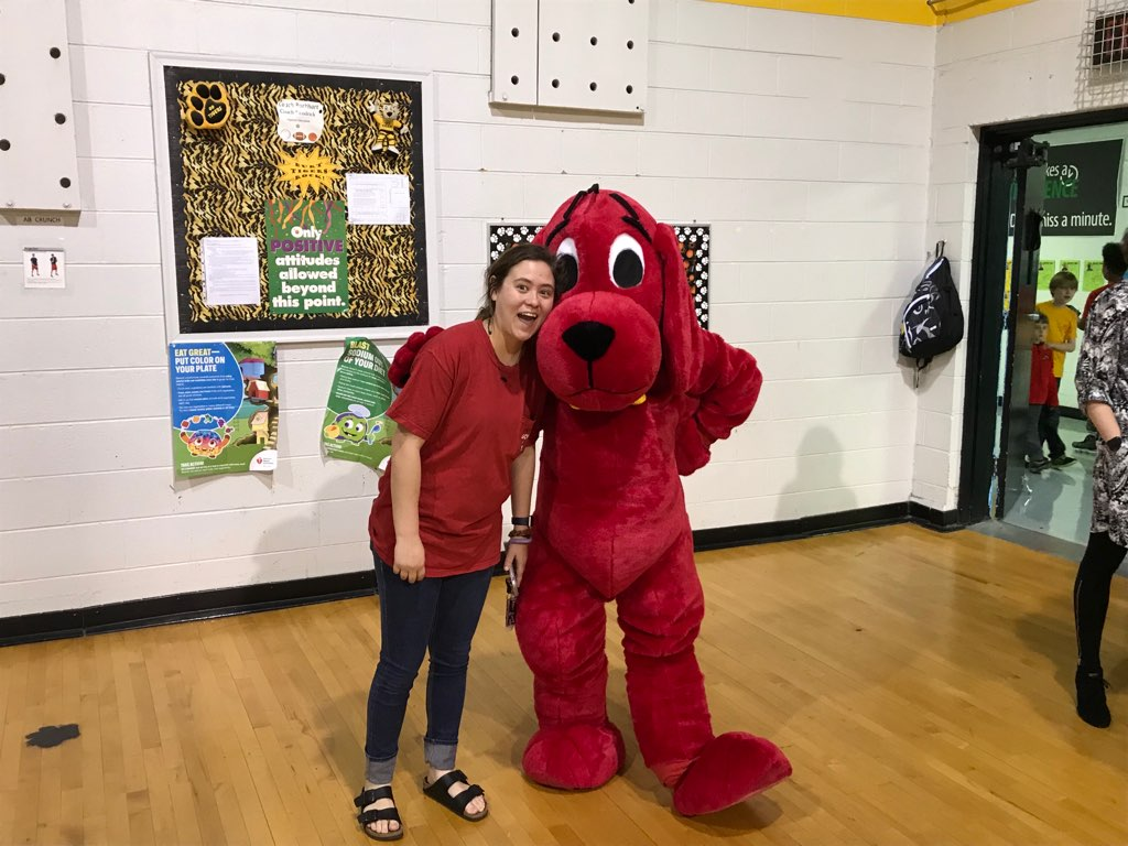 APSU student and Clifford the big red dog at Math and Literacy Family Night at Burt Elementary