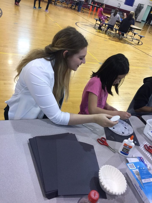 APSU students helps Burt Elementary student at Math and Literacy Family Night