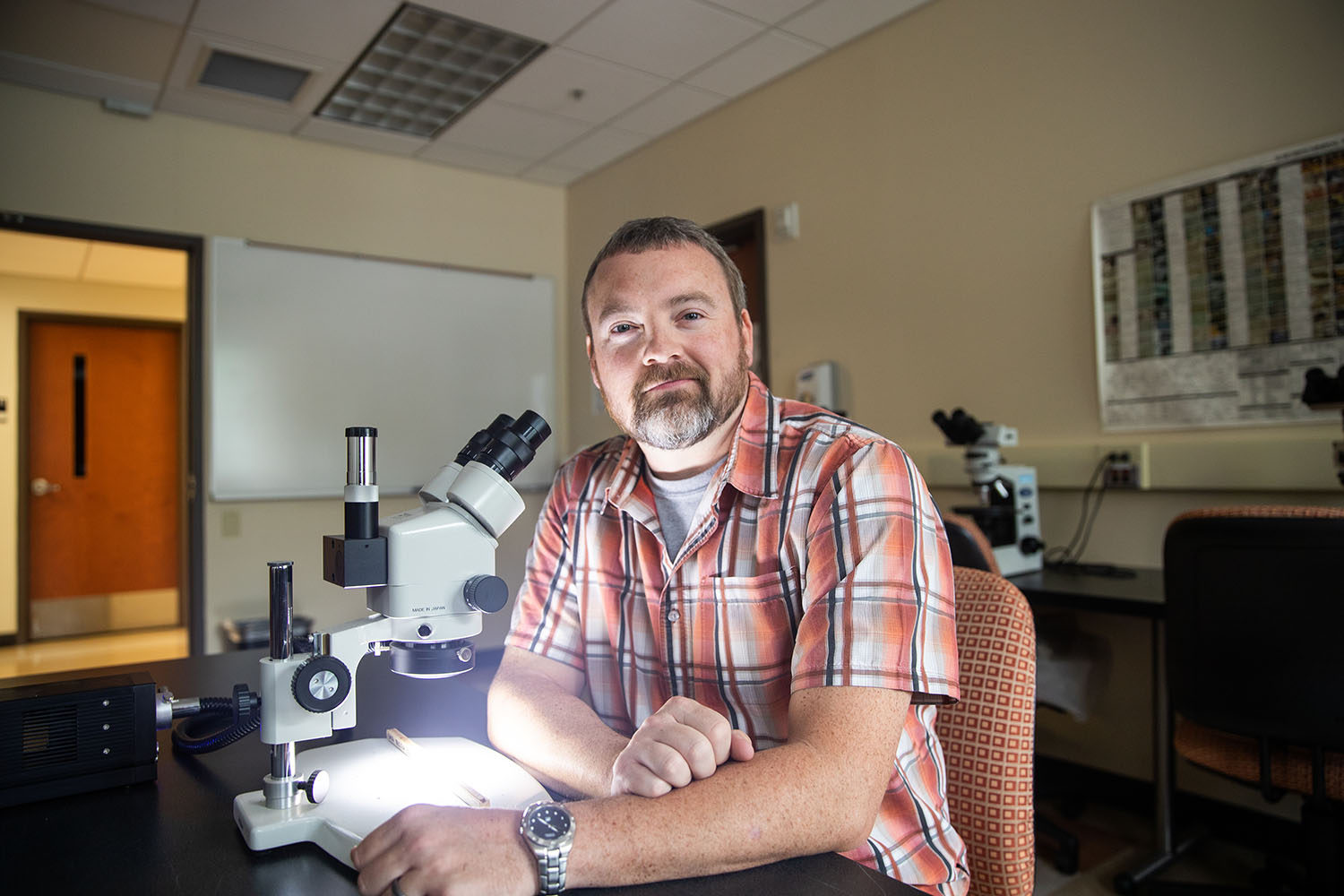 Chris Gentry poses for photo in McCord lab