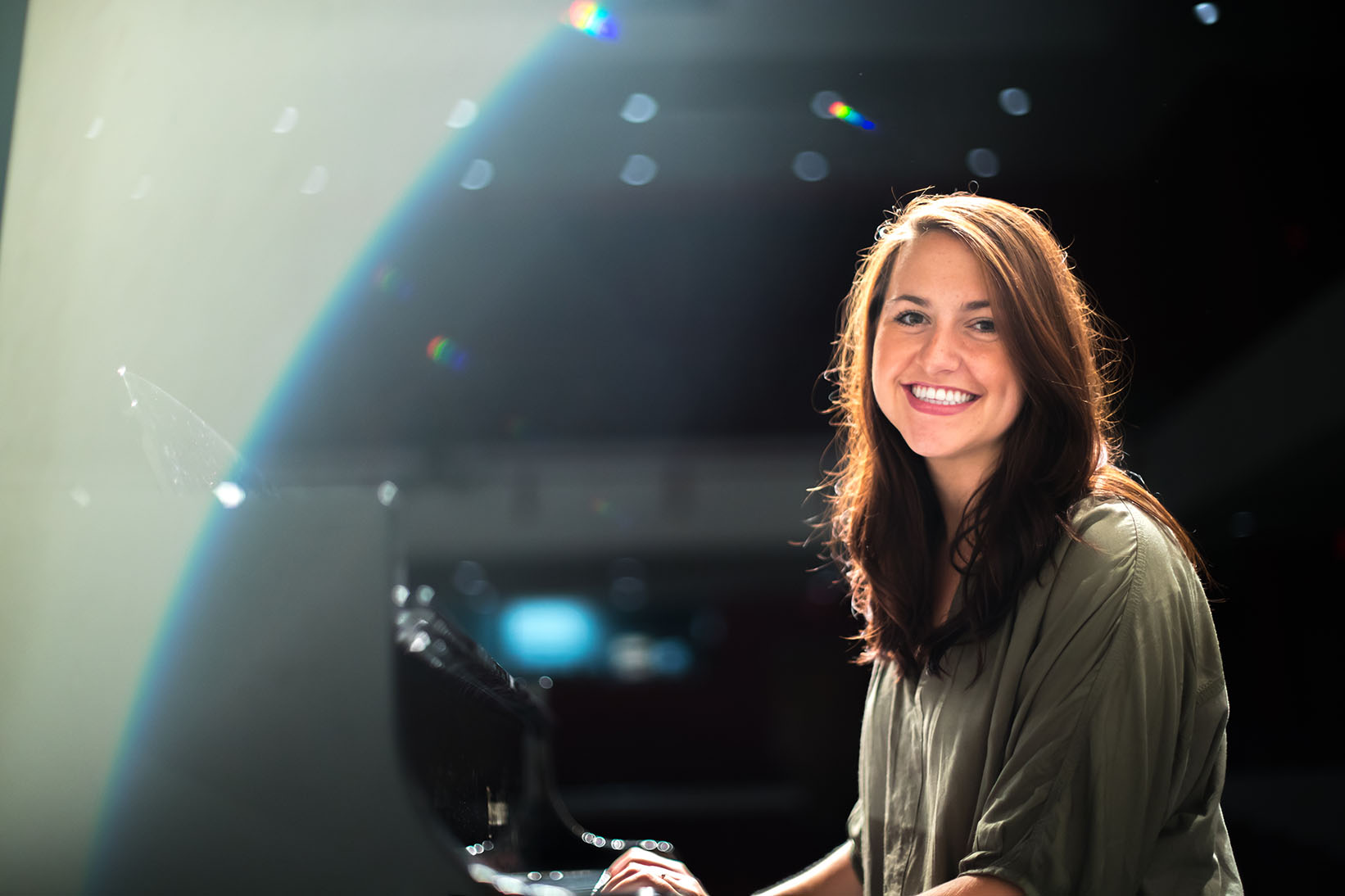 Susannah White poses for photo at MMC concert hall piano