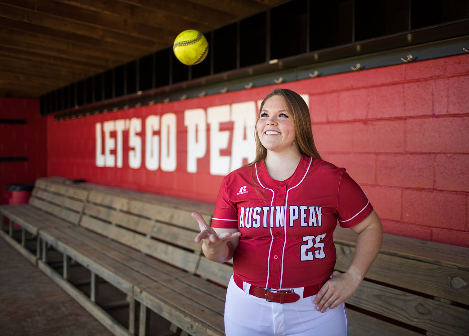 Alexis Hill poses in Softball dugout