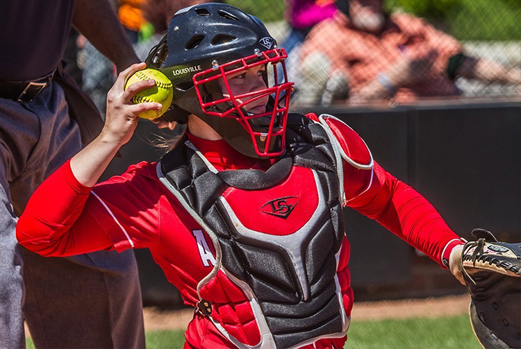 Alexis Hill throws softball during game