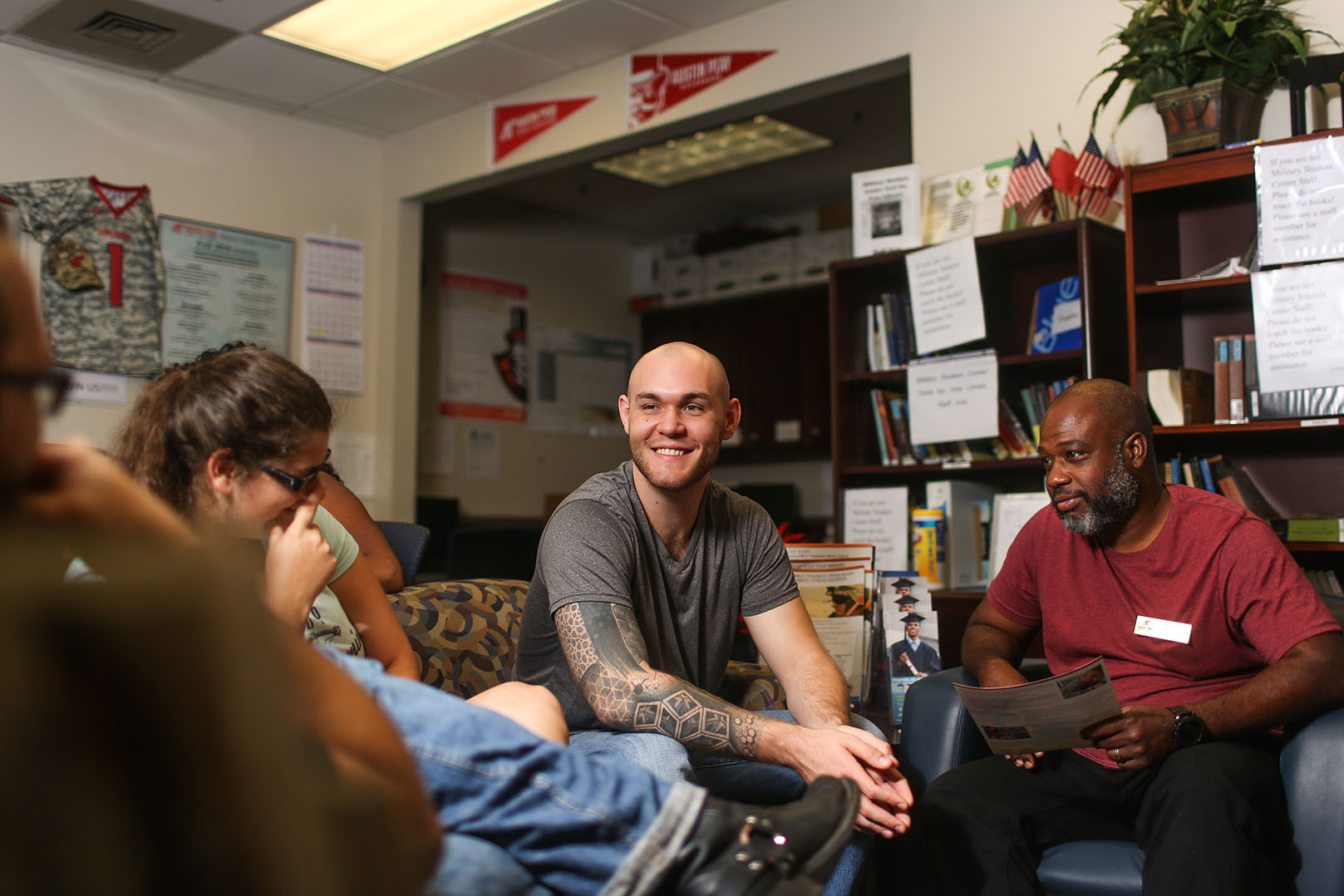 Austin Derden talks with other military students in MSC