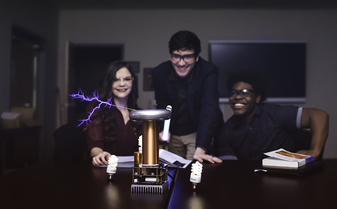 Joshua Allen and other STEM students use Tesla Coil for experiments