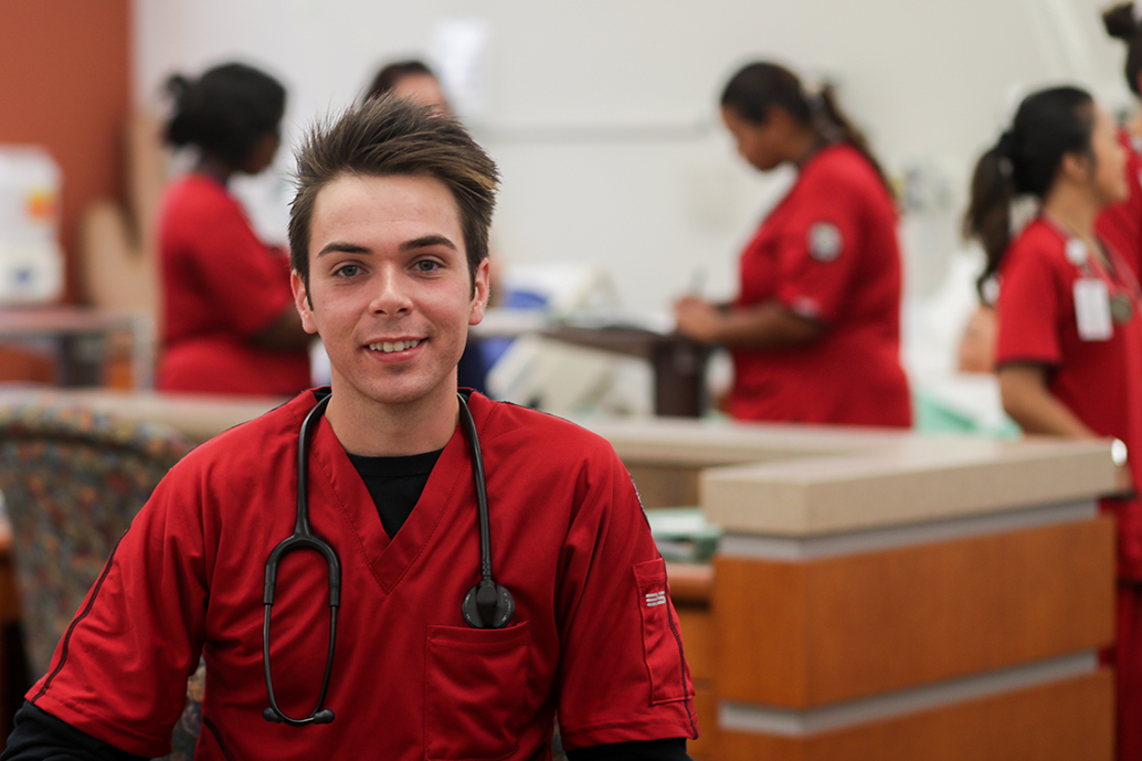 Oliver Smith poses for photo in McCord nursing lab