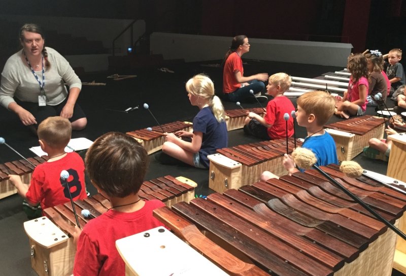 Campers playing Orff instruments
