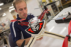 Student works on drone