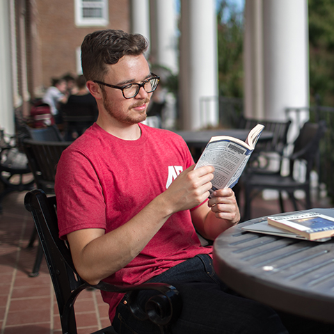 Students study in and around Harned building