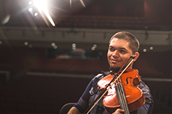 student plays violin in Mabry Concert Hall