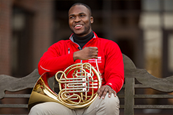 Emmanuel Méjeun poses with French Horn