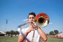 Garrett Coscoluella performs in football field