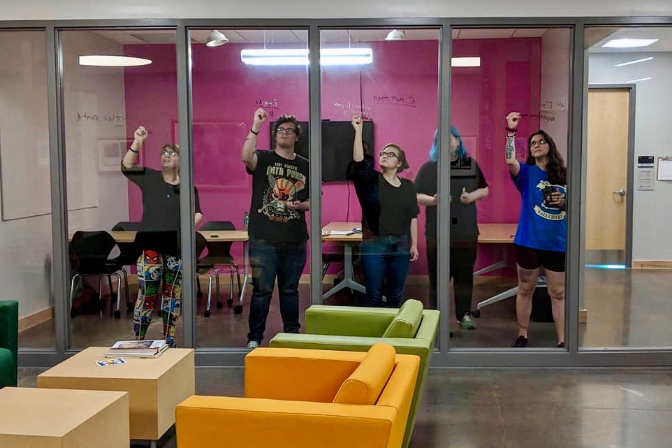 Last year's APSU team that competed in the 24 Hours Animation Contest use a glass wall to map out their ideas for the film.