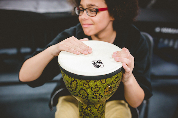 CMCSS student playing a drum.
