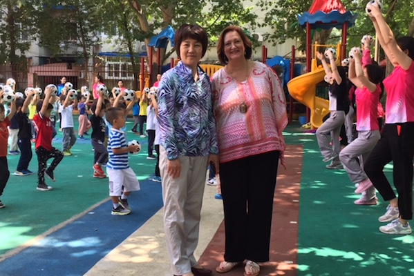 Dr. Bruster with a kindergarten teacher in China