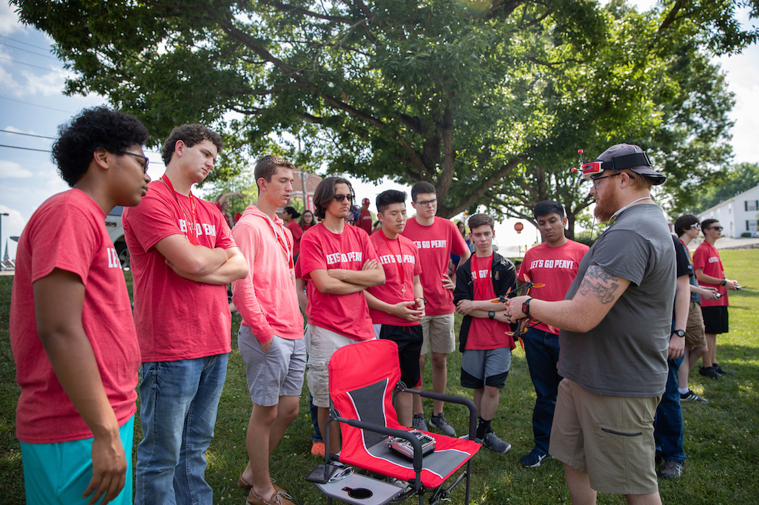 Michael Hunter of the Drone Club at Austin Peay shows off one of his racing drones to the Governor's School for Computational Physics students.