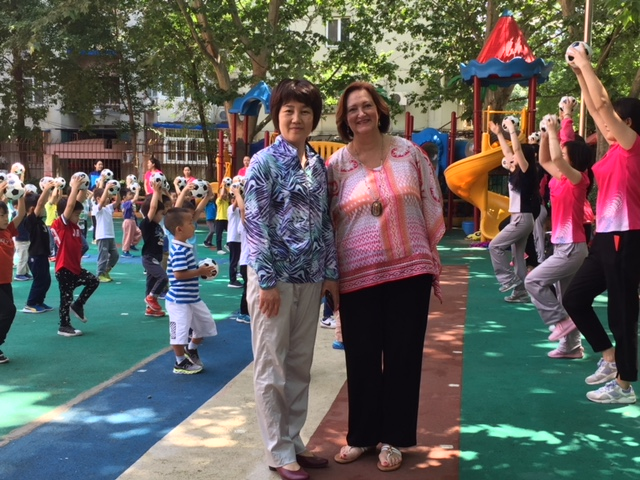 Dr. Bruster with kindergarten teacher in China.