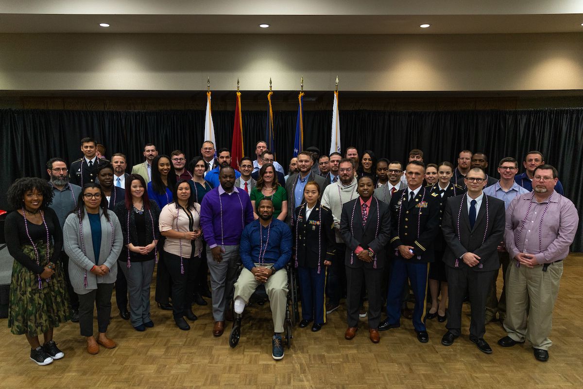 Military graduates earn a specially designed coin and cords from Austin Peay in addition to their degrees. Pictured are the December 2018 honorees.
