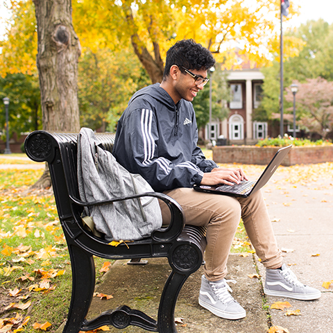 Student studies on browning lawn