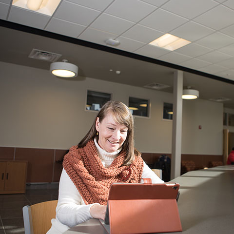Joy Cheatham poses for photo in Maynard Math and Science building