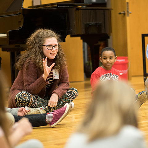 Austin Peay students teach music to children.