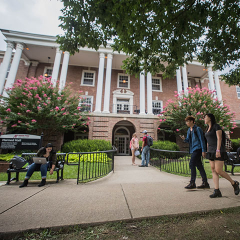 Students walk by Harned hall