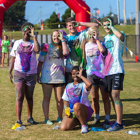 Students showing monocles after the Gov Color Run