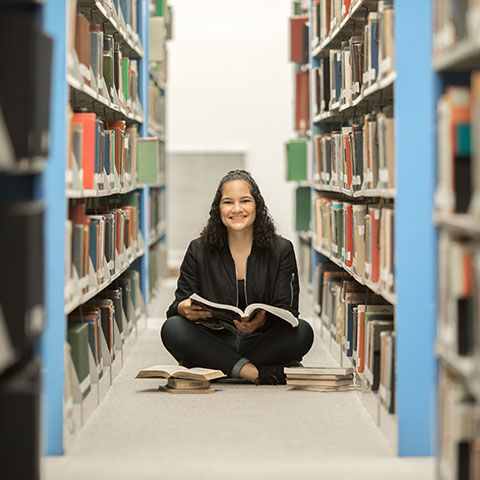 Psych major Natalie Castillo sits in library