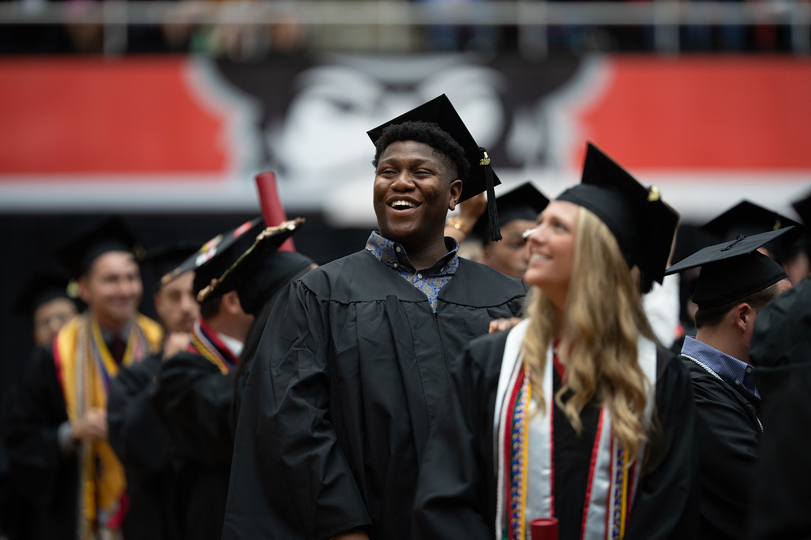 Students smile at commencement