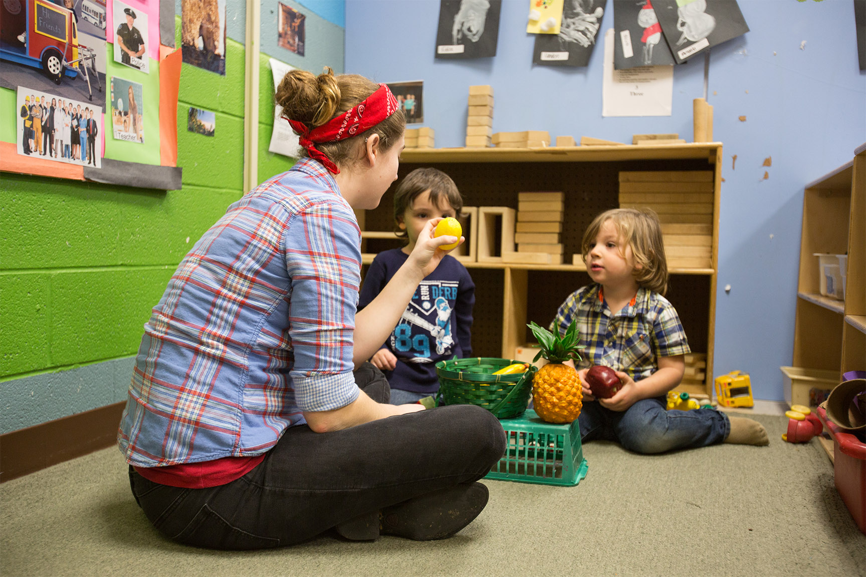 Student with children in the Child Learning Center.