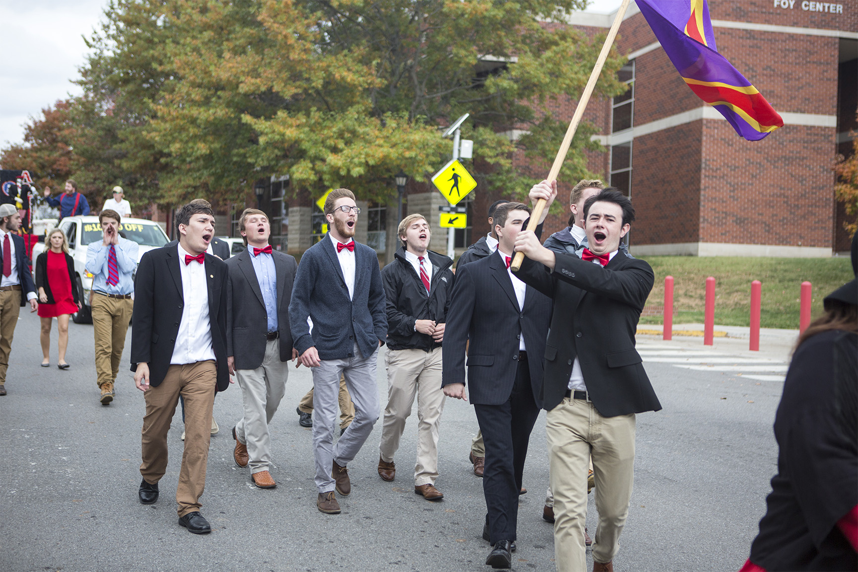 A fraternity during the Homecoming parade