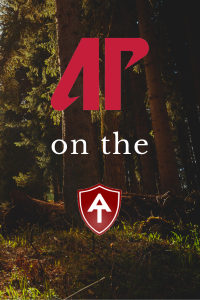 Ap on the AT logo on Wooded background image